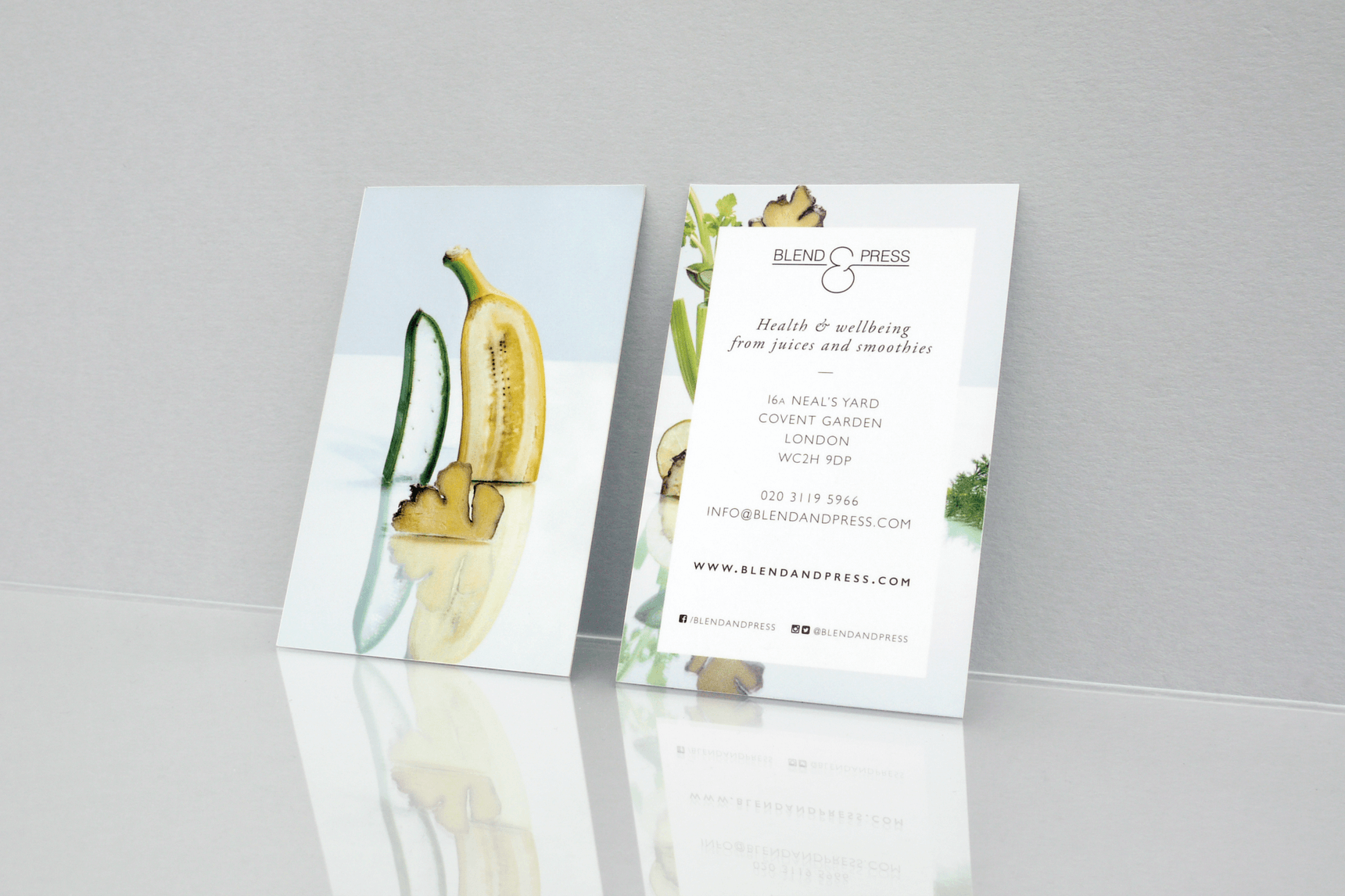 Front and back of business card showing fresh fruit