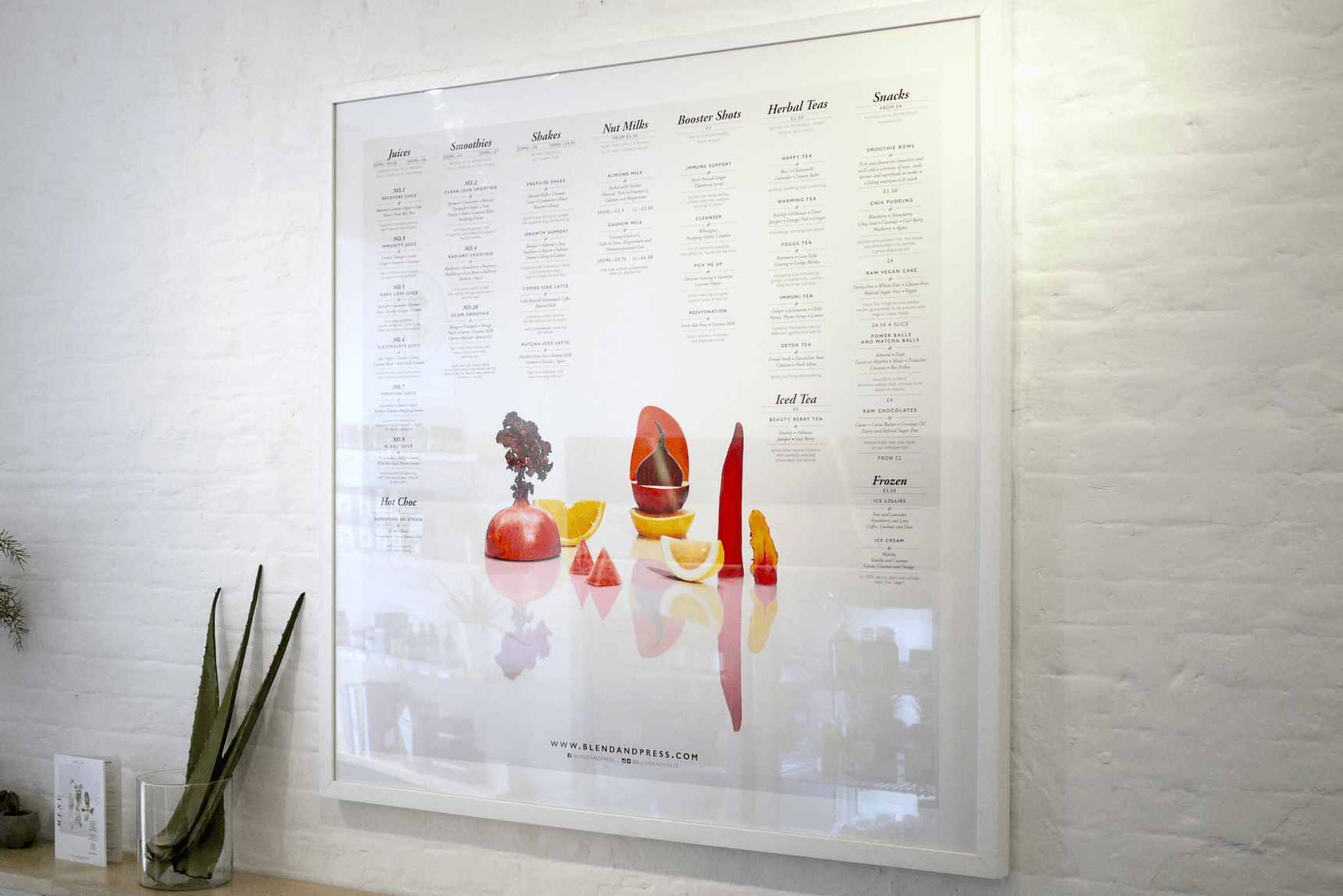 Framed menu board on wall in store for blend and press