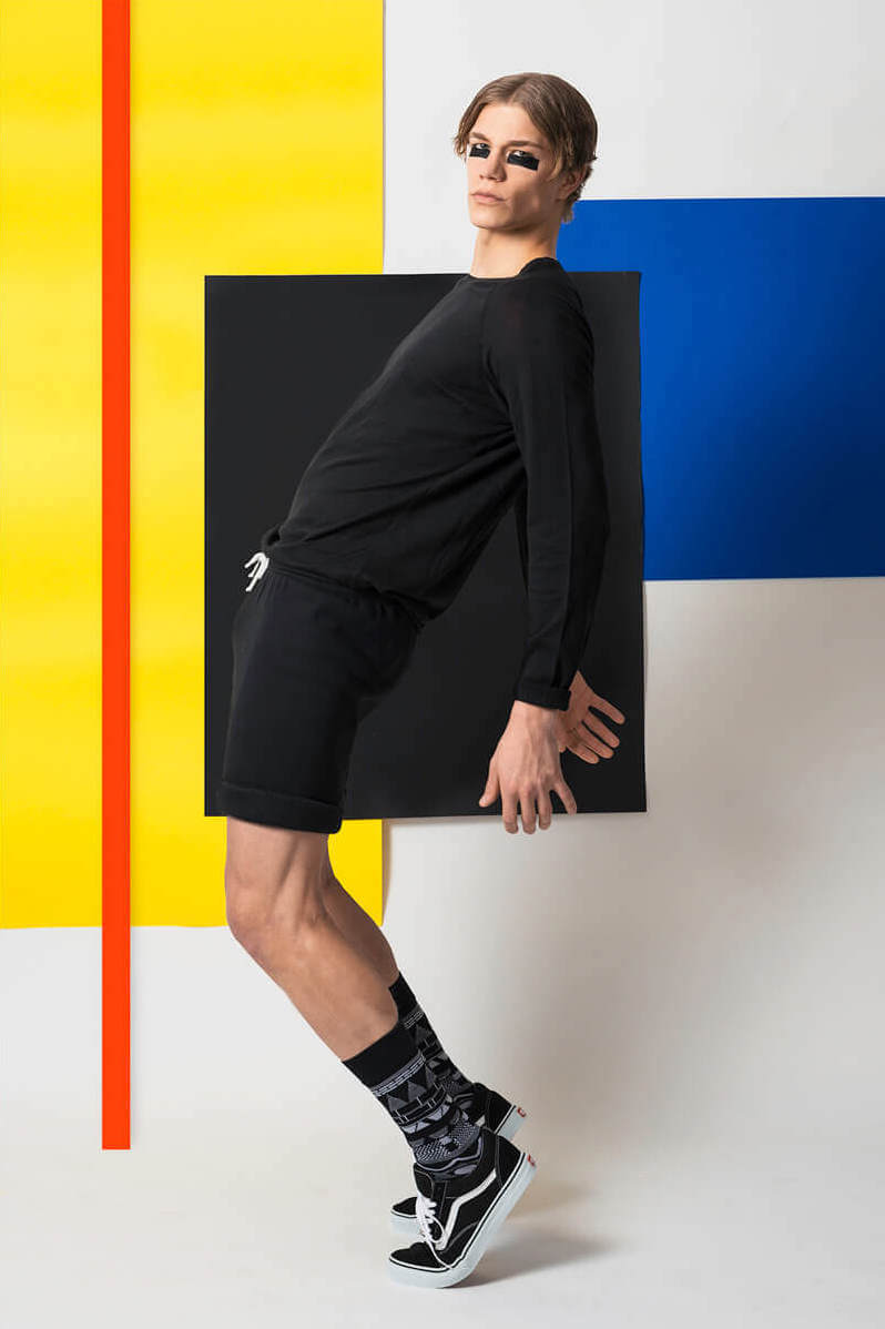 Male model in front of colourful bauhaus background
